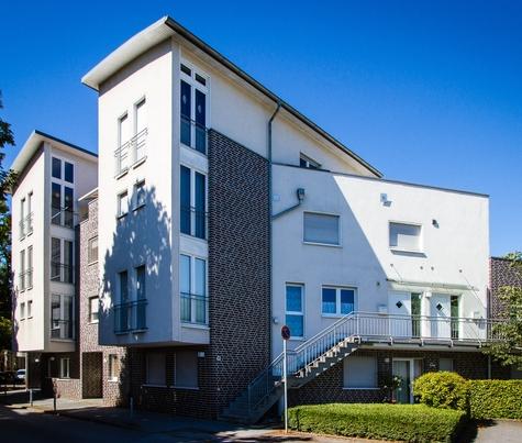 Architekturbüro Hinkelmann | Grösseres Mehrfamilienhaus mit vertikale Staffelung